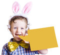 Smiling young boy wearing pink bunny ears easter bunny blank yellow sheet bubble isolated white Royalty Free Stock Photos