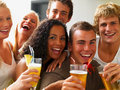 Smiling young boys and girls holding drinks Royalty Free Stock Images