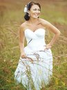 Smiling young brunette bride at field Stock Image