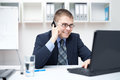 Smiling young business man talking on cell phone Royalty Free Stock Photo