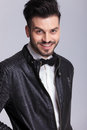 Smiling young business man wearing a leather jacket. Royalty Free Stock Photo