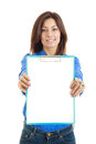 Smiling young business woman showing blank signboard over white in blue shirt background isolated Stock Images