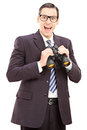 Smiling young businessman holding binoculars isolated on white background Royalty Free Stock Photos