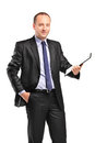 A smiling young businessman holding a clipboard Royalty Free Stock Image