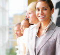 Smiling young businesswoman with colleagues Royalty Free Stock Images