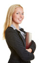 Smiling young businesswoman with portfolio holding her application Stock Images