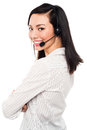 Smiling young call center executive cheerful female wearing headset Royalty Free Stock Image