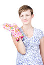 Smiling young cook wearing an oven glove attractive or housewife a large pink standing giving the camera a friendly smile isolated Stock Photos