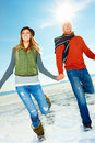 Smiling young couple enjoying their winter Royalty Free Stock Images