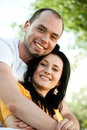 Smiling young couple in love closeup portrait of outdoors Royalty Free Stock Photos