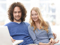 Smiling young couple shopping on the internet happy Royalty Free Stock Photography
