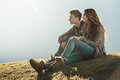 Smiling young couple sitting on the grass Royalty Free Stock Photo