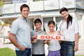 Smiling young family buying new house Stock Image