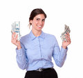 Smiling young female holding cash dollars portrait of a while is looking at you on isolated white background Stock Image