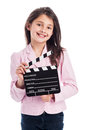 Smiling young girl with clapperboard beautiful to camera while holding a movie makers isolated on studio white background Stock Images