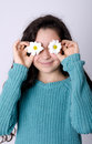 Smiling Young Girl Covering her eyes with Flowers Royalty Free Stock Photo
