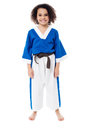 Smiling young girl in karate uniform Royalty Free Stock Photo