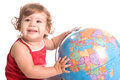 Smiling young girl playing with a world globe map Royalty Free Stock Photos