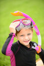 Smiling young girl with swimming goggles and snorkel after getting out of the pool Royalty Free Stock Photo