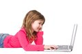 Smiling young girl typing on laptop horizontal portrait of a against isolated white background Royalty Free Stock Photography