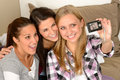 Smiling young girls taking self portrait at home Royalty Free Stock Photography