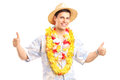 A smiling young guy in hawaiian costume giving thumbs up Stock Photos