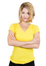 Smiling young happy woman, student, pointing at a blank yellow t-shirt Royalty Free Stock Photo