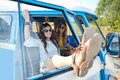 Smiling young hippie women resting minivan car Royalty Free Stock Photo