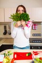 Smiling young housewife mixing fresh salad at kitchen Stock Photos