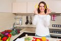 Smiling young housewife mixing fresh salad with pepper Royalty Free Stock Photography
