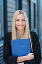 Smiling young job applicant with her cv in a stylish black jacket Stock Photos