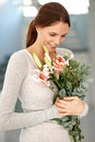 Smiling young lady holding flower bouquet Royalty Free Stock Image