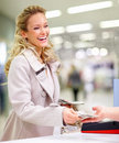 Smiling young lady paying for merchandise at a mal Royalty Free Stock Photography