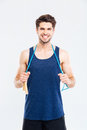 Smiling young male athlete standing and holding skipping rope Royalty Free Stock Photo
