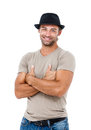 Smiling young man with arms crossed a handsome standing against white background Royalty Free Stock Photography