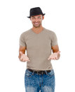 Smiling young man gesturing against white background Royalty Free Stock Image