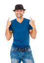 Smiling young man gesturing a handsome against white background Royalty Free Stock Images