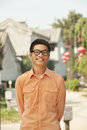 Smiling young man with glasses in nanluoguxiang beijing china Royalty Free Stock Photography