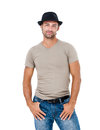 Smiling young man with a hat posing against white background Royalty Free Stock Images