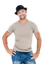 Smiling young man with a hat posing against white background Royalty Free Stock Image