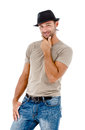 Smiling young man with a hat posing against white background Royalty Free Stock Photo