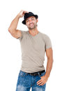 Smiling young man with a hat posing against white background Royalty Free Stock Photography