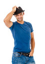 Smiling young man holding a hat posing against white background Stock Images