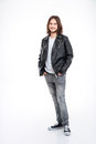 Smiling young man with long hair in black leather jacket Royalty Free Stock Photo