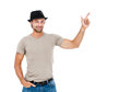 Smiling young man pointing copy space against white background Royalty Free Stock Images