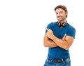 Smiling young man pointing copy space against white background Royalty Free Stock Photo
