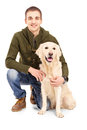 Smiling young man posing with a retriever dog Stock Photo