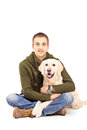 Smiling young man posing with a retriever dog isolated against white background Royalty Free Stock Photography