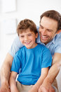 Smiling young man and small boy enjoying Stock Photos