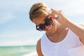 Smiling young man in sunglasses on summer beach Royalty Free Stock Photo